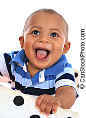 smilling 7-month old baby boy portrait - happy big smiling...