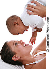 Happy Mother Holding Baby High Key Portrait