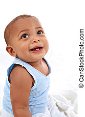 Adorable Baby Boy Looking Up on Soft White Background