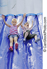 Children play  - Funny kids and off the inflatable slides