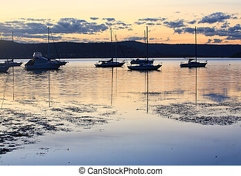 Boats moored at dusk - Boats and yachts moored at dusk