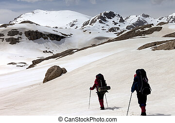 Two hikers on snowy plateau Turkey, Central Taurus...
