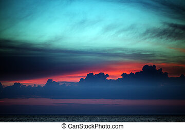 Multicolor sunset sky with clouds on lake