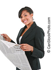 Young Businesswoman Reading Newspaper