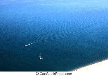 Mediterranean Sea - Aerial view of motorboat sailing through...