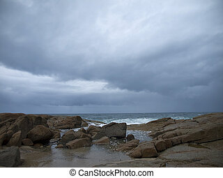 Stormy wheather - The storm threatens the rocky beach. The...