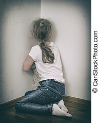Little girl crying in the corner Domestic violence concept