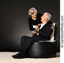 Couple drinking tea - Senior couple drinking tea sitting in...