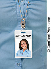 Employee Badge Close-up with Female Worker Photo on It