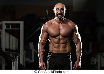 Portrait Of A Physically Fit Mature Man In A Healthy Club...