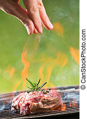 Grilled beef steaks on fire