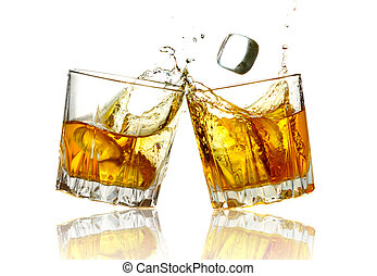 Two whiskey glasses clinking together, isolated on white.