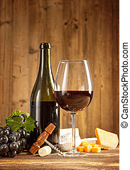 Wine still life on wooden planks - Wine with grapes and...