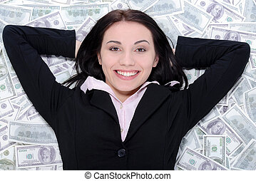 Business woman and money - Young business woman resting upon...
