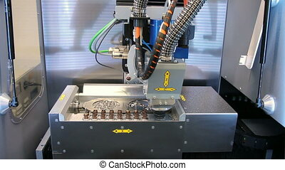 Dental CNC engraver in action. Dental milling machine...