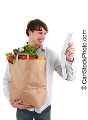 Smiling Young Man Holding Groceries Paper Bag and Receipt -...