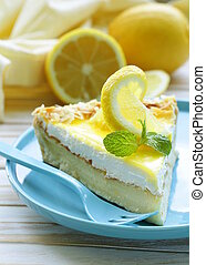 piece of lemon cake tart decorated with fresh lemon and mint