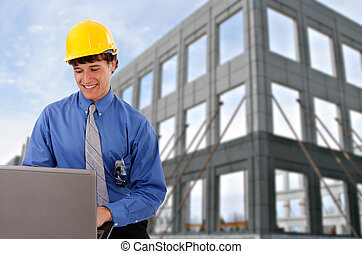 Construction Worker Checking Laptop at Site
