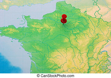 Pushpin on map of France - Red pushpin on Paris city, map of...