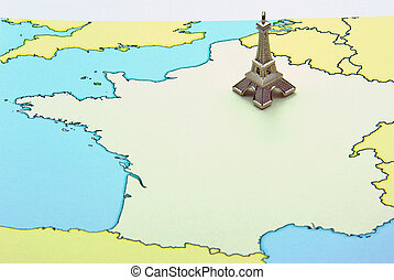 Eiffel Tower miniature on map - Miniature of Eiffel Tower on...