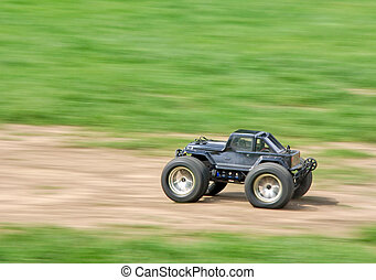 Speeding RC car - Speeding radio controlled car on the grass...