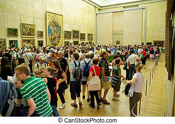 Tourists in Louvre Museum - PARIS, FRANCE - AUGUST 03: Group...