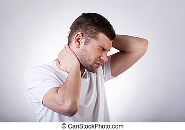 Man suffering from neck pain - Young man suffering from neck...