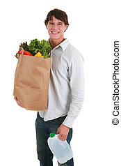 Smiling Healthy Looking Young Man Holding Groceries Paper...