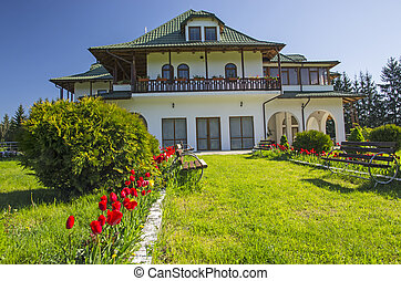 House and garden - Beautiful house with a garden in front.
