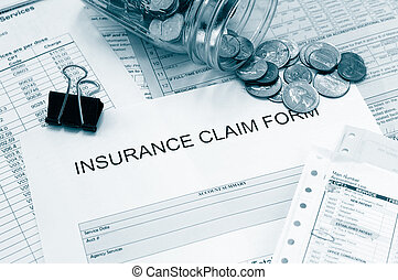 Medical bills - Assorted medical bills and a claim form with...