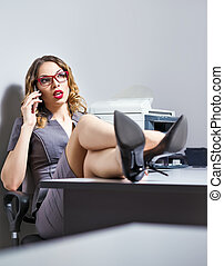 Beautiful young business woman talking on the phone - A...