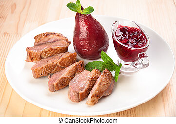 Roast duck breast with raspberry sauce and pears