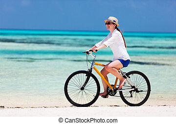 Young woman biking