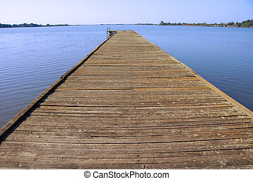 Lake landscape - old wooden pier on Palic lake in Serbia