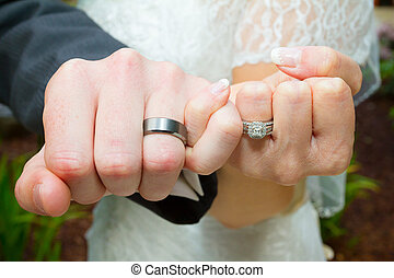 Pinky Swear Wedding Ring Hands - Bride and groom put their...