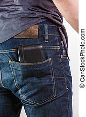 Closeup. Careless man with wallet on back pocket. Theft. -...