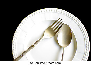 brass spoon and fork on white plate background