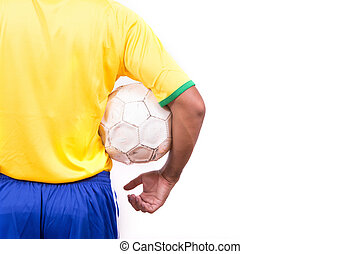 soccer player holding a soccer