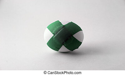 Reproductive Challenges - A single egg with green bandage...