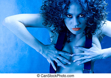 The militant woman. Portrait of sexy girl in blue light
