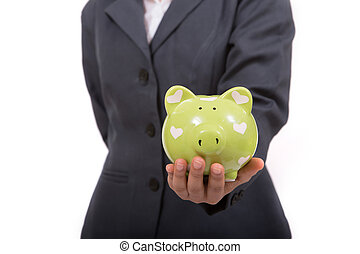 Beautiful asian woman holding piggy bank
