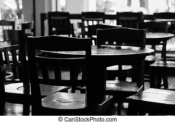 black & white of empty tables and chiar in coffee shop