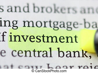Investment - Newspaper text highlighted with yellow marker...