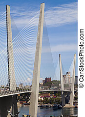 Big suspension bridge against the blue sky in the sunny day