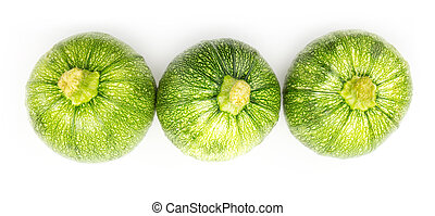 Three round zucchinis in a row isolated on white