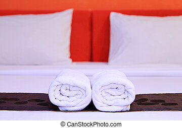 White clean towels on the hotel bed