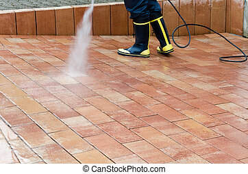 High pressure cleaner - Workers cleaning with high pressure...