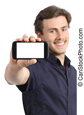 Handsome young man showing a blank smart phone display...