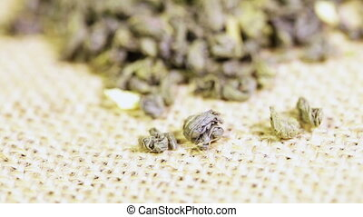 Green tea Jasmine on burlap - Pile of green tea Jasmine...