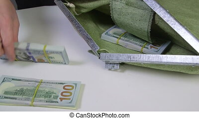 Money folded in cash collection bag and sealed - Dollars...